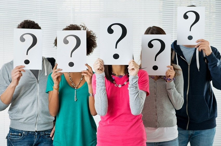 5 People standing with question marks in their hands